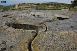 il-misqa watering troughs tanks created by neolithic man or the Maltese Temple Builders near hagar qim temple malta