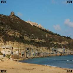 Gnejna Bay sandy beach Malta huts in cliffside Manikata Mgarr