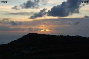 setting sun west coast malta natural lunar solar observatory near Ta-Baldu cart ruts